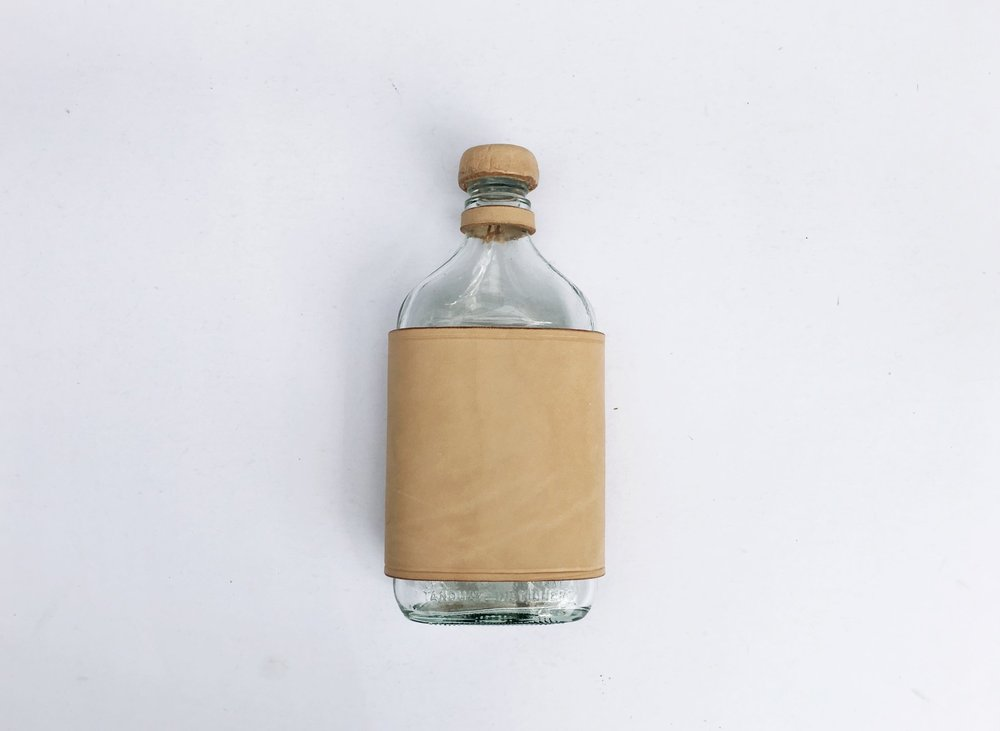 XL UPCYCLED GLASS FLASK - We gave these former rum/Honey bottles a whole new look with some natural Veg Tan Leather.