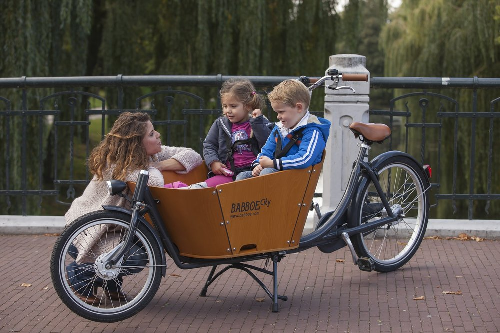 The Babboe City Bakfiets bicycle is a perfect solution to get your family to daycare, to the playground, or to grandma and grandpa's house.