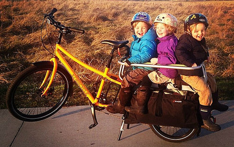 """On the Xtracycle Edgerunner, kids ride on the """"Flight Deck"""" and are secured by the """"Hooptie"""" ring. It really is this much fun! Try our demo Xtracycle for a weekend with your family and see how it stacks up."""