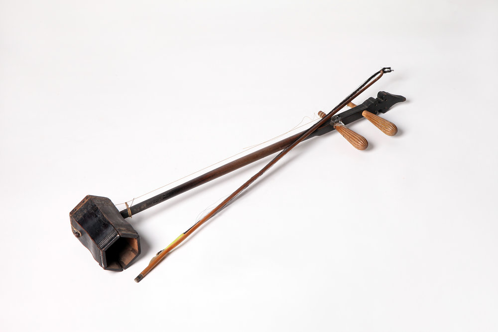 "Erhu   can be traced back to Tang dynasty over 1000 years ago, known as  Xiqin . It is a traditional bowed instrument.  Erhu , literally ""two-stringed  huqin "", is also known as  nanhu  (literally ""southern  huqin "") or  wengzi . It is a major bowed instrument ( caxian  instrument) among the Chinese ethnic instruments."