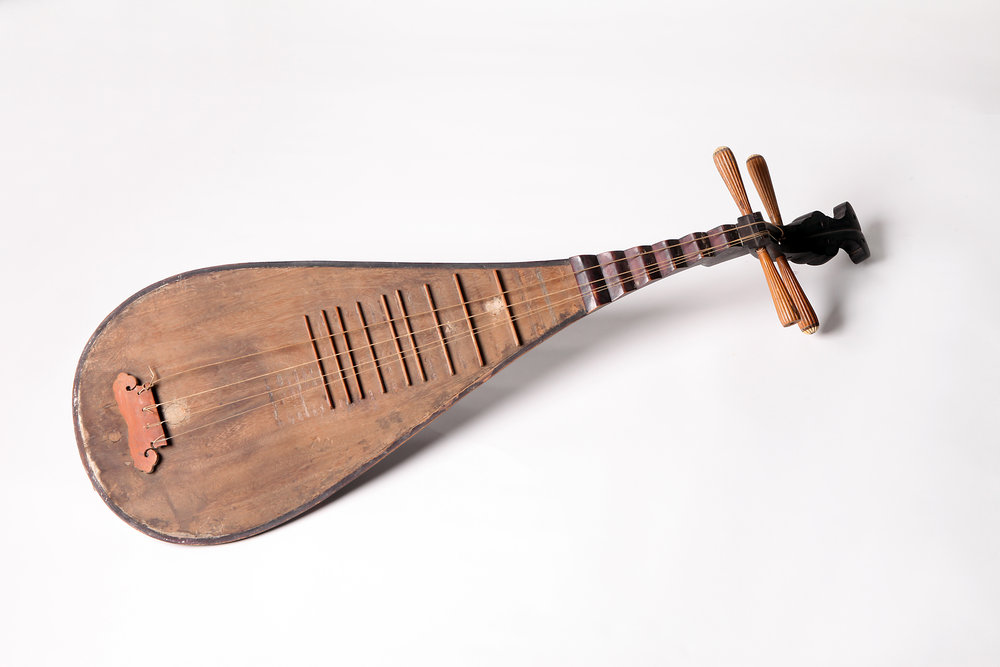 "Pipa is the name of a traditional Chinese instrument. It is a stringed lute originated in West Asia and arrived in China during the Sui dynasty, known as quxiang (bent-neck) pipa with only ledges but no frets, played by a plectrum. Then in Tang dynasty, a musician named Fei Luoer borrowed the frets of ruan and affixed them on pipa, then the pipa played today came into being, which has a history of around 1600 years. According to Xu Wei's Nanci xulu (a Ming history of drama), ""now southern songs are sung to the accompaniment of dizi, guan, sheng and pipa"", which suggests that pipa is among the traditional accompanying instruments for kunshan tune at early time. Since Ming and Qing dynasties, musicians have been playing pipa with four ledges and thirteen frets, of which the backboard is typically made of hongmu (rosewood), wumu (ebony), zitan (red sandalwood) or huali (padauk), when the belly is made of tongmu (paulownia). The four strings of pipa are tuned A, D, E and A respectively and its full range is 3 octaves and a half. Its lower range sounds deep and full, mid range bright and upper range very clear. There are many fingering techniques: for right hand, there are tan, tiao, jiatan, gun, shuangtan, shuangtiao, fen, gou, mo, shu, kou, fo, sao, and lun; while for left hand, there are rou, yin, daiqi, xu'an, jiaoxian, fanyin, tui, wan, chuo, and zhu. Both hands combined can produce various chords."