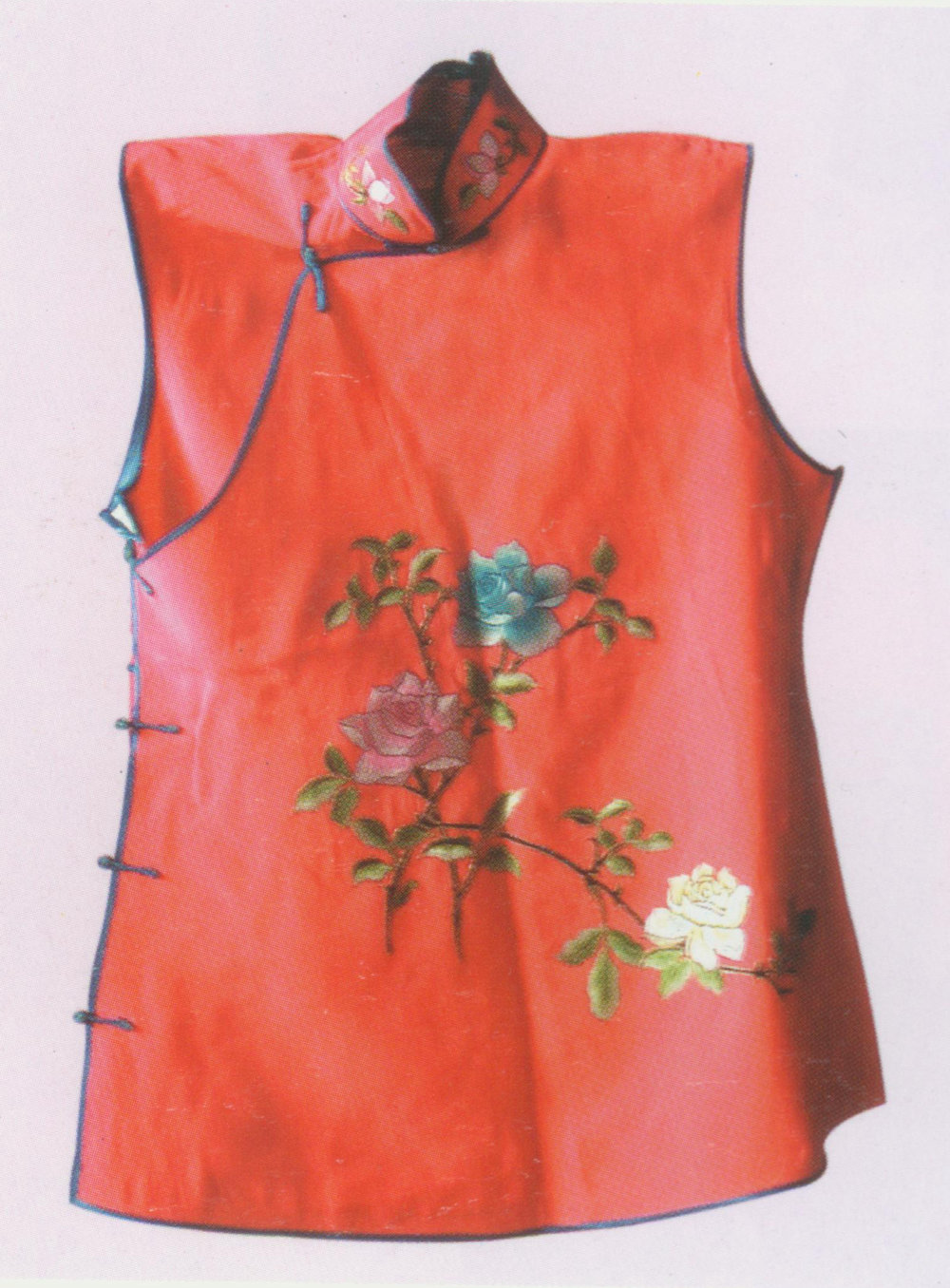 "Small Red Waistcoat  Costume,   also known as ""red livery for solders"" ( hong zu kan ). It has a round neck and a distinctive Chinese jacket buttons down the front (i.e.  duijin ). It is embroidered with flowers in round frame and its matching frets, ancient coins and dragons. It is made of red satin and edged with coloured-cloth. The inside surface which is made of a yellow cloth with black tiger-skin pattern can be turned outwards as the outside surface – in other words, the waistcoat is a reversible. The small red waistcoat is usually worn by walk-on roles, such as Xi Xiaojun in  The Snow Jade Cup  and Da Gui in  The Nine-Lotus Lattern ."