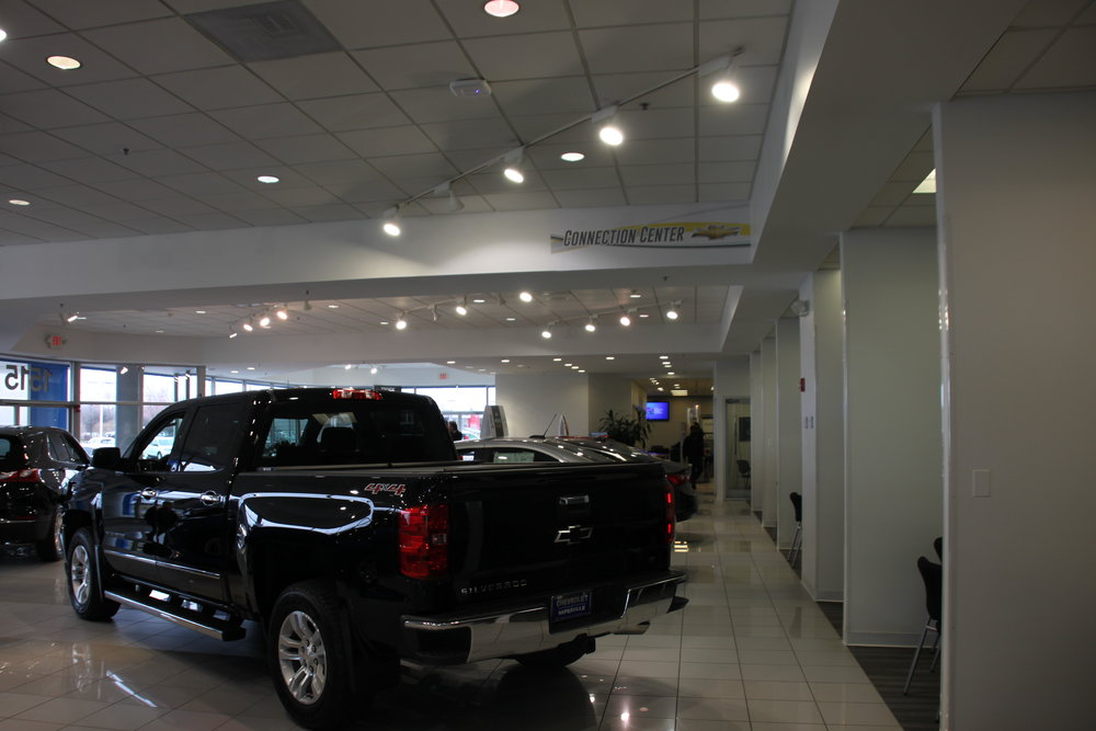 Painters Inc. painting interior of Chicagoland Chevrolet car dealership