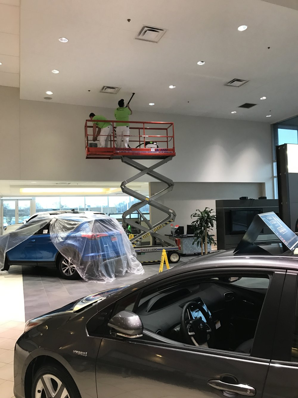 Painters Inc. painting interior of Chicagoland car dealership location