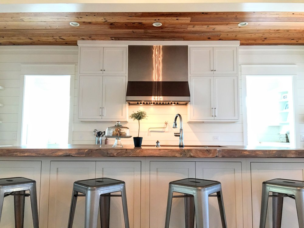 Live Edge Oak kitchen island and reclaimed heart pine ceiling trim
