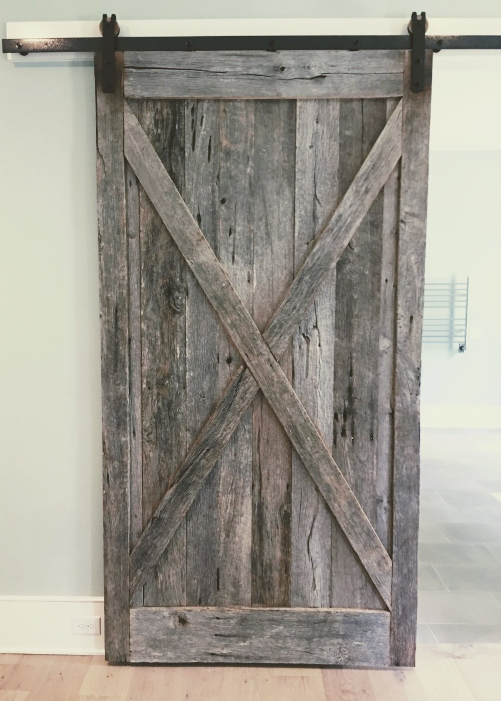 Reclaimed barn door | custom residence | I'On Neighborhood