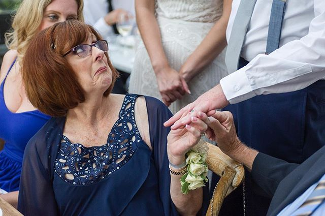 Mother of the groom is impressed with her son's new ring. #weddingphotography #weddingphotojournalism #vermontweddingphotographer #documentaryweddingphotography #weddingring #groom #weddings #nikon