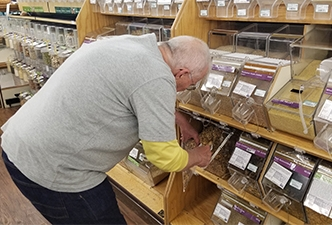 Larry, stocking up on his favorite bulk Paleo granola!