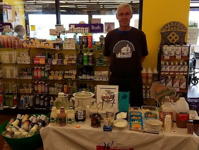 Fred from Trust Local Foods samples many Wisconsin-made foods available at the Co-op!