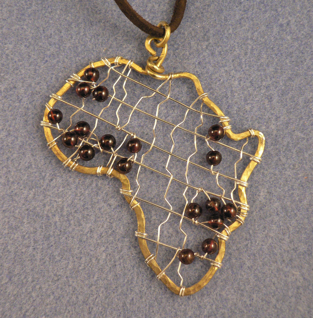 "Africa Travels, Brass and Silver Wire, 4"" x 3"""