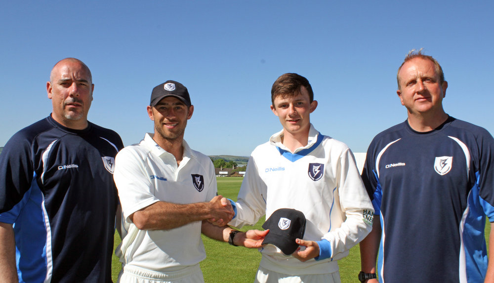 2 Stephen Doheny receives his Lightning cap from skipper John Anderson. Mark Jones and Ted Williamson are also pictured..jpg