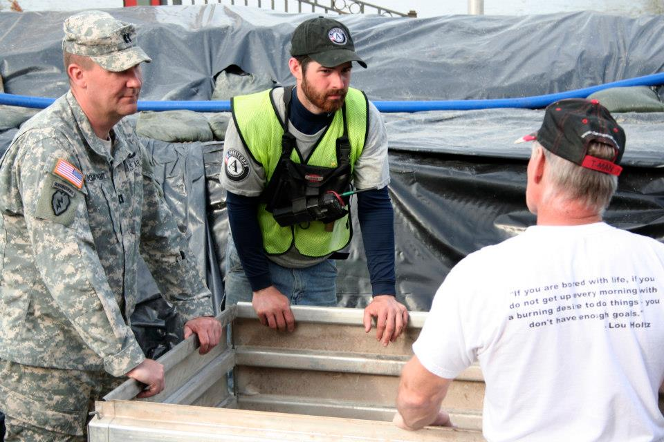 During Year 19, Will Burks coordinates with the National Guard and other volunteer agencies on the removal of flood waters from behind flood protection barriers in response to the flooding in Clarksville, MO, 2015