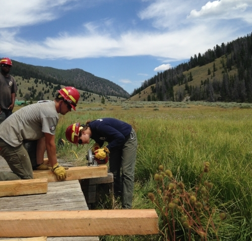 Year 23 members, Jake Friesen and Rebecca Miller, assist in building a new boarded walkway at Sheepshead Picnic Area, Butte, Montana, 2017
