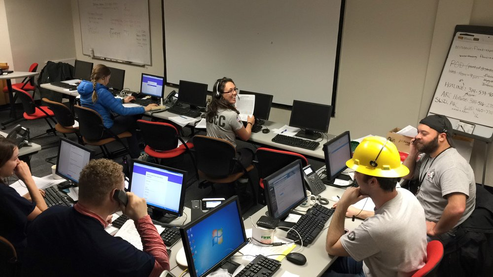 Year 21-22 member, John Purdue, assists with other AmeriCorps and NCCC members in follow-up calls to survivors on additional services needed after the 2015 winter flooding in Missouri