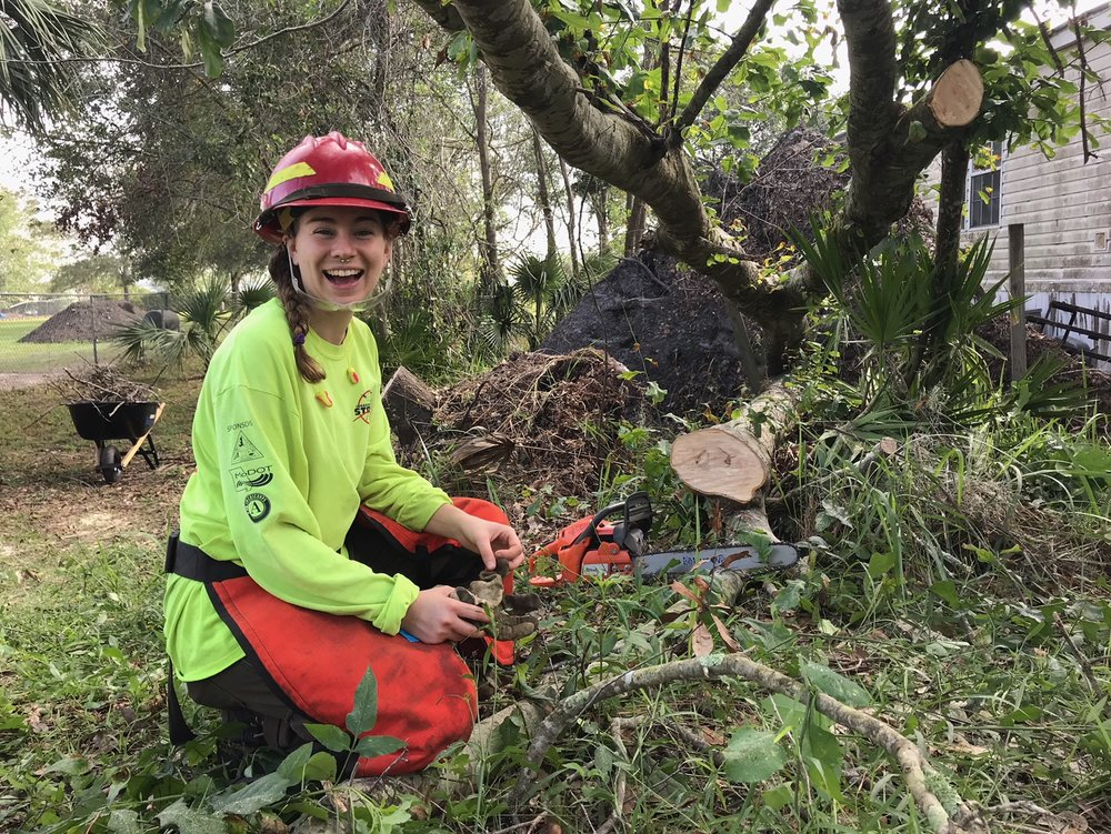 Year 24 member, Sarah Prill, assists alongside other AmeriCorps members in bucking hazard trees in the aftermath of Hurricane Irma, Florida, 2017