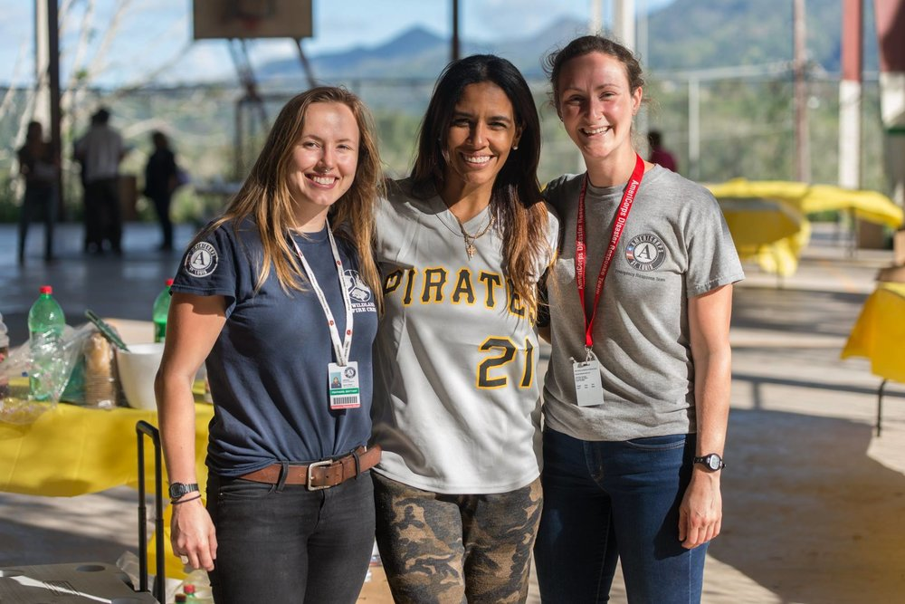 Second Years Brenna Thompson (ERT 23 and VISTA 24) and Brittany Feathers (ERT 23 and 24) pose with a Voluntary Organization Active in Diaster (VOAD) partner in the mountains of Puerto Rico.