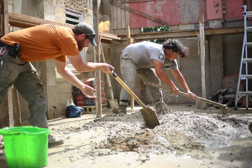 Frankie (left) and first year Eli Schmidt mixing concrete in Lares. Photo: Wyatt Berrier