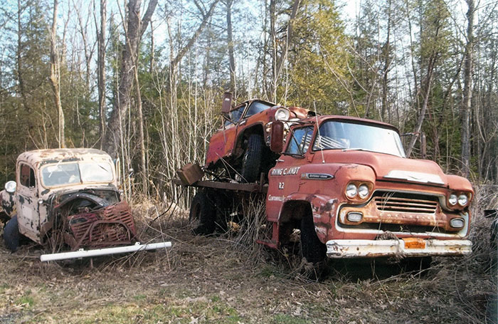 This photo highlights two vintage trucks that we don't see every day. On the left is a 1946 Dodge and on the right is a 1959 Chevrolet C-50 flatbed.