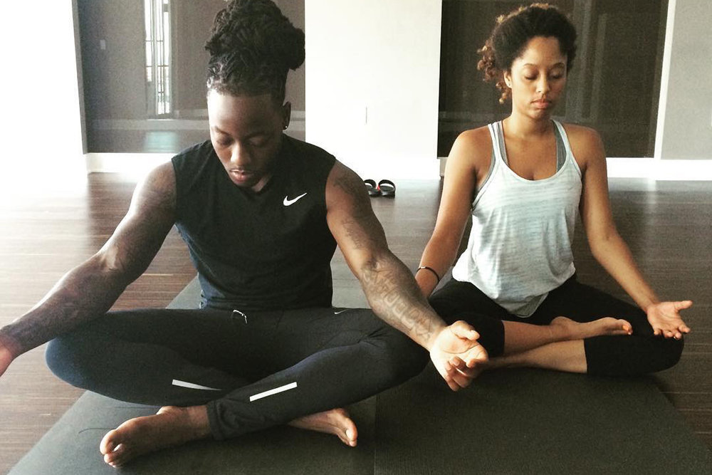 Shelah and boyfriend Acehood practicing yoga and mediation.