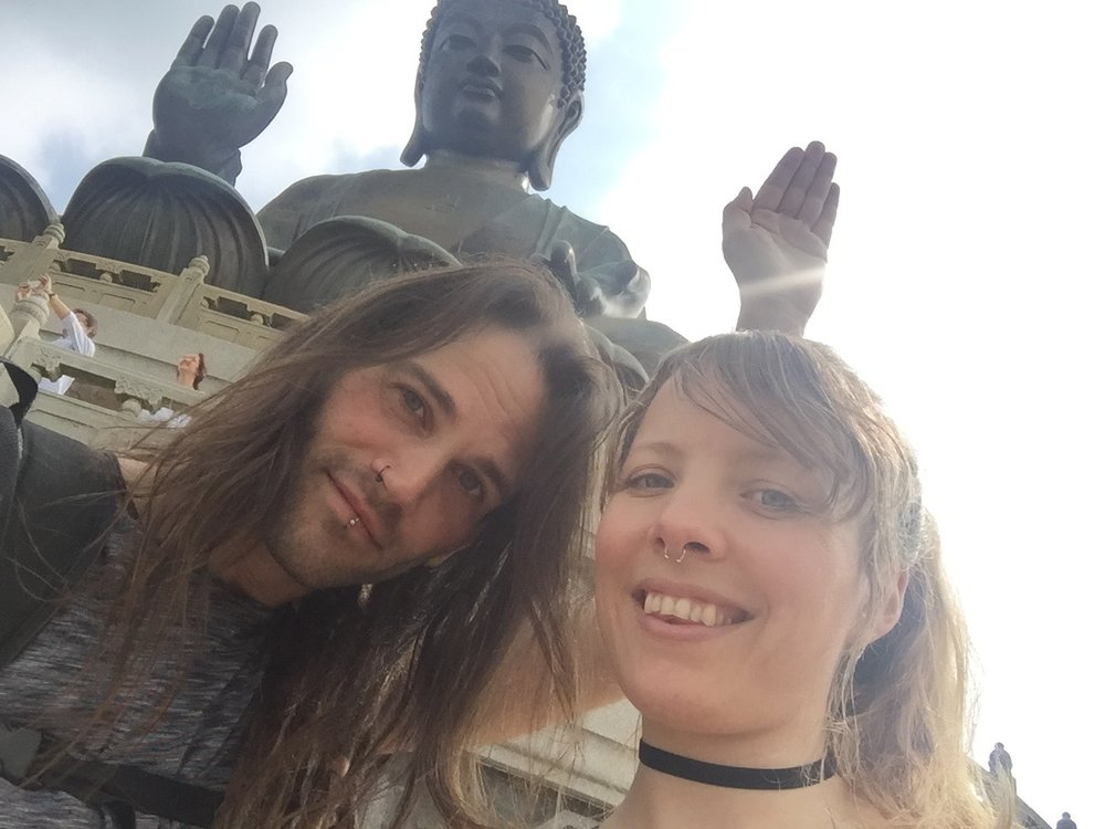 marc funny hand with tian tan buddha nnong ping.jpg