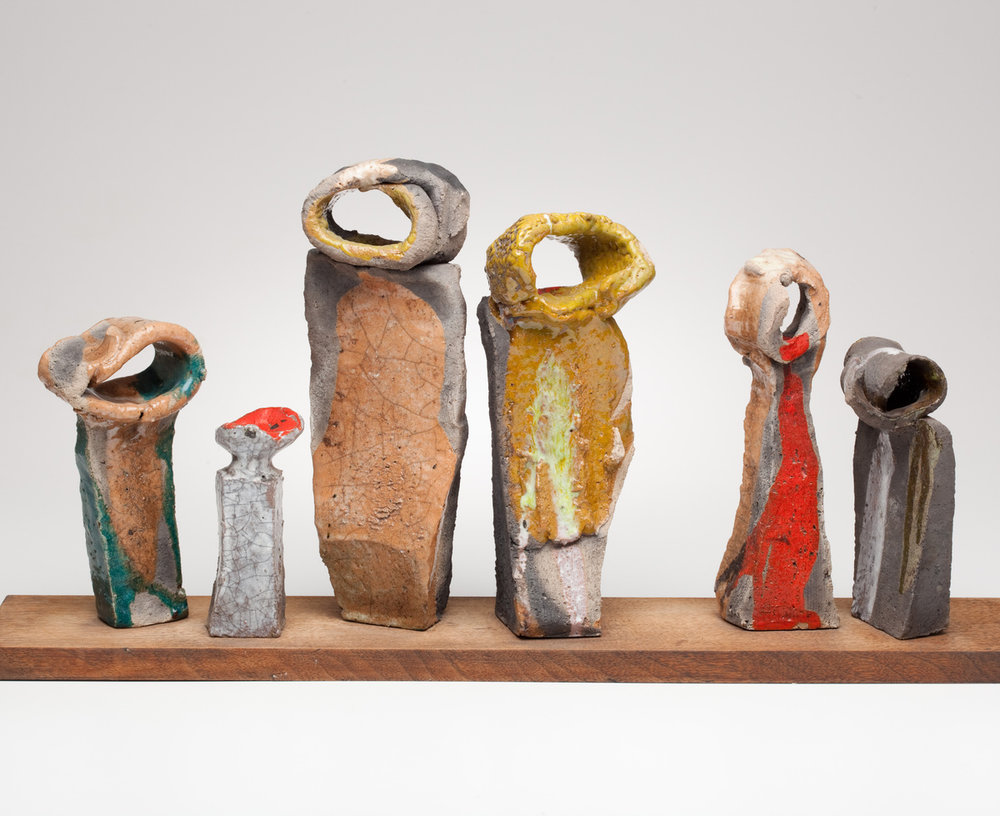 "Betty Feves, ""Six Figures"" (date unknown), Raku on wooden base, Collection of Feves Family, Museum of Contemporary Craft (photo by Dan Kvitka)"
