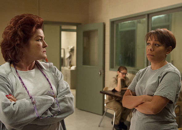 Kate Mulgrew and Selenis Leyva in Season 3 of  Orange Is the New Black.  (Photo by JoJo Whilden/Netflix)