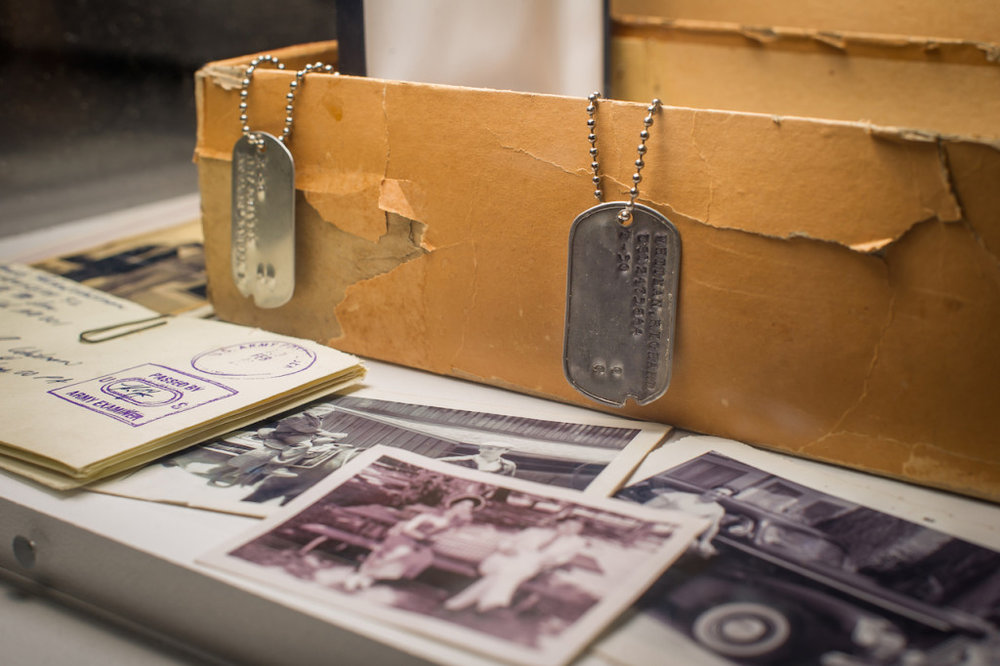 Detail: Don Draper's box of secrets revealed, Dick Whitman's dogtag, letters, and family photos (photo by Thanassi Karageorgiou, courtesy the Museum of the Moving Image)