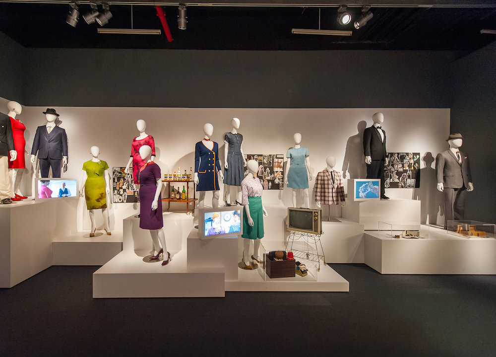 "Installation view of ""Creating Character"" section, costumes and props for characters including Don Draper, Peggy Olson, Joan Holloway/Harris, Roger Sterling (photo by Thanassi Karageorgiou, courtesy the Museum of the Moving Image)"