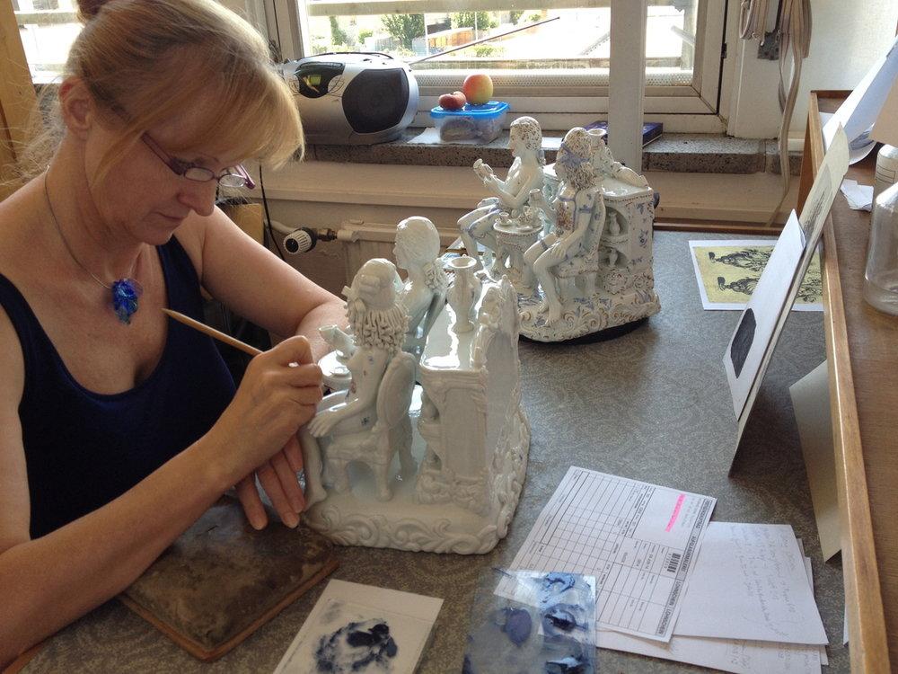 A Meissen artist at work on Antemann's sculpture