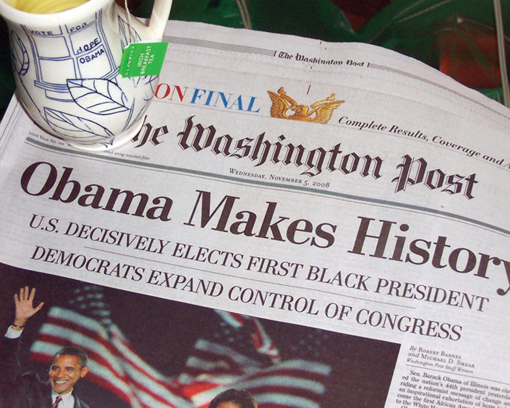 Pots in Action photo of Julia Galloway's Obamaware cup with the historic front page of  The Washington Post.