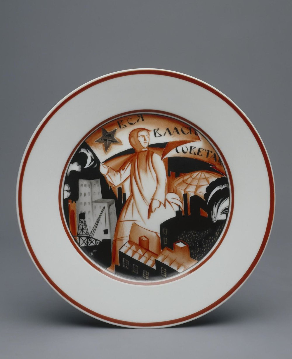 """A Red Man,"" dinner plate painted with the slogan ""All Power to the Soviets,"" designed by Mikhail Adamovich, painted by Maria Kirillova.  State Porcelain Factory, USSR, 1921. Hermitage Museum, transferred in 2002 as part of the collection of the Museum of the Imperial Porcelain."