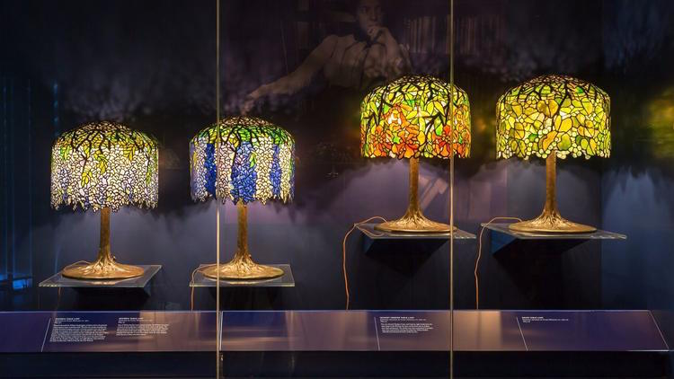A display of Tiffany Studios glass lamps, ca. 1900.  Photograph by Corrado Serra, courtesy of the New York Historical Society.