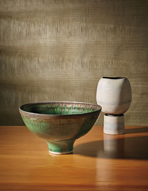 Ceramics by Lucie Rie and Hans Coper with a woven textile by Peter Collingwood. Courtesy of Phillips.