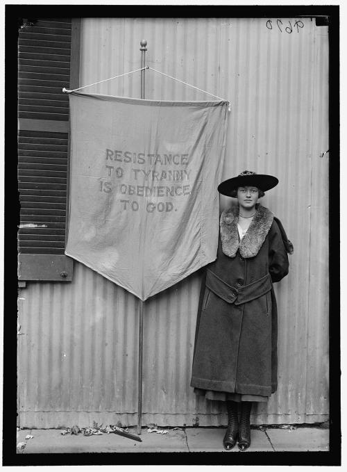 Tyranny , 1917 Photograph of an American Suffragette with her banner by Harris & Ewing, Harris & Ewing Collection at the Library of Congress, Washington, DC