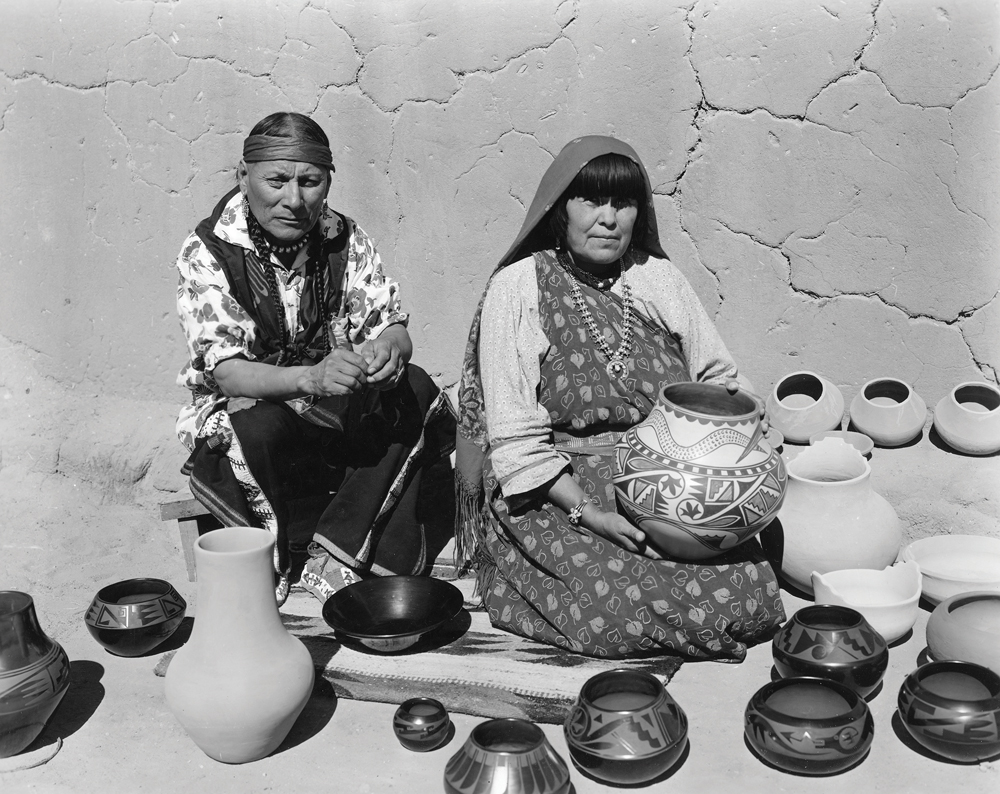 Julian and Maria Martinez displaying finished pottery, San Ildefonso Pueblo, New Mexico, undated.