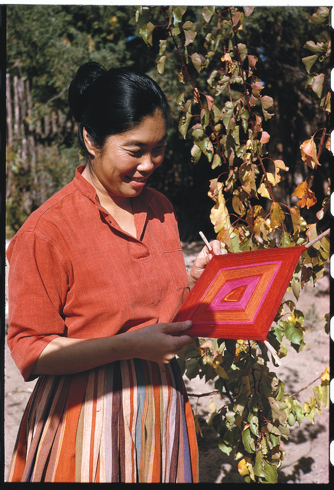 Todd Webb, Alice with handweaving, 1963, color slide.  Alice Kagawa Parrott Artist File, the American Craft Council Library & Archives, Minneapolis, MN