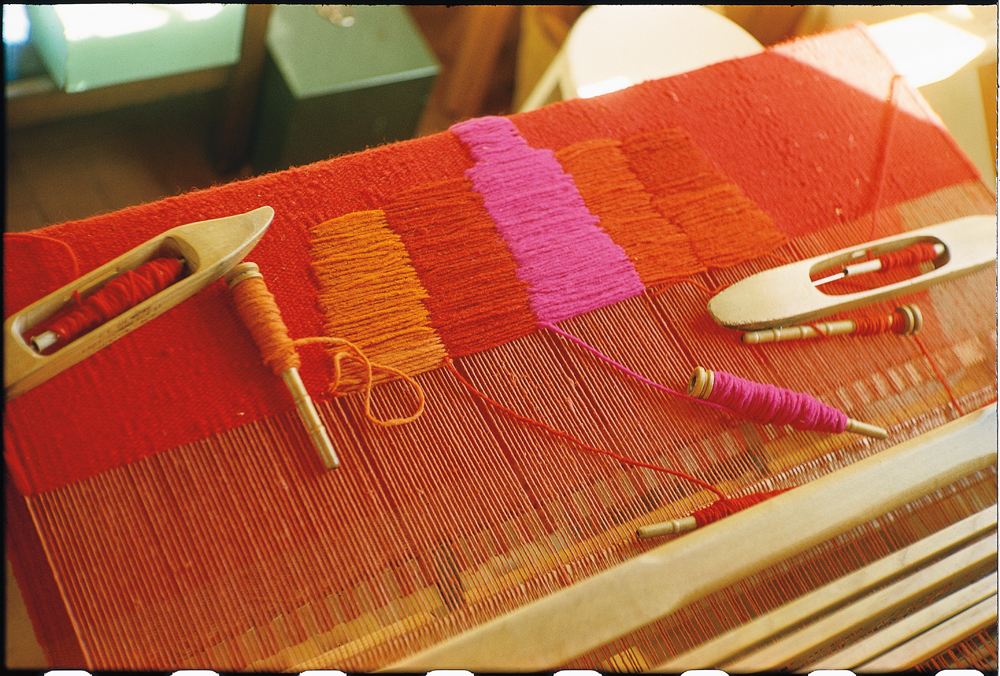 Todd Webb, Alice at the loom weaving on the rug for World's Fair exhibit, 1963, color slide  Alice Kagawa Parrott Artist File, the American Craft Council Library & Archives, Minneapolis, MN