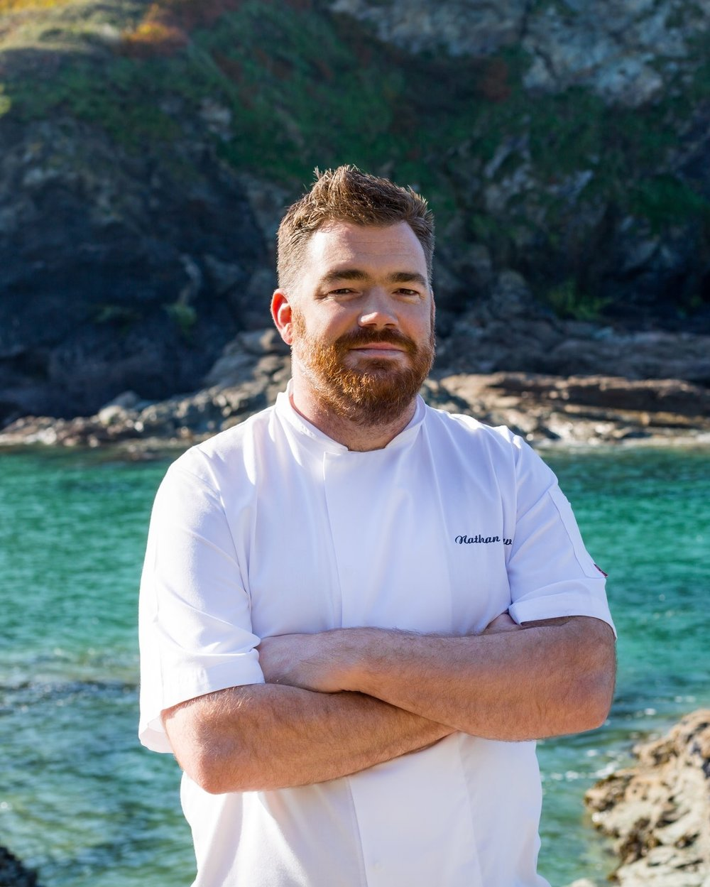 Nathan Outlaw   . Originally, from Kent, Nathan now calls Cornwall home and is a proud ambassador of all things Cornish. Having attending Thanet College in Broadstairs, his love for seafood cookery ignited when he came to Cornwall as a young chef to work with Rick Stein.   Nathan has two restaurants and a pub in Cornwall, Restaurant Nathan Outlaw and Outlaw's Fish Kitchen in Port Isaac and The Mariners public house in Rock.   Further afield are Outlaw's at The Capital Hotel, Knightsbridge and his first venue outside the UK, 'Nathan Outlaw at Al Mahara', in the world famous Burj Al Arab Jumeirah in Dubai.     Nathan's interest in education and training saw him join forces with Cornwall College to open Academy Nathan Outlaw where enhanced learning opportunities are offered to young  Chefs and Front of House.  He is also in demand at industry conferences where his expertise is valued by those training and by experienced chefs.   Nathan has written several successful cookery books, all except one focussing on seafood cookery.     His easy manner, enthusiasm and obvious passion for his work make him a hit with audiences of all ages at food festivals and he regularly appears on TV programmes like 'Saturday Kitchen' and 'Masterchef Professionals'.