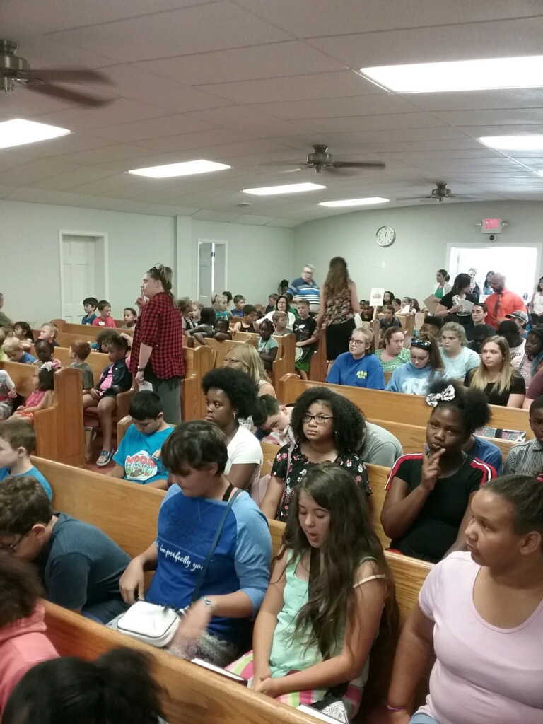 - Campers filled the auditorium in preparation of the day.
