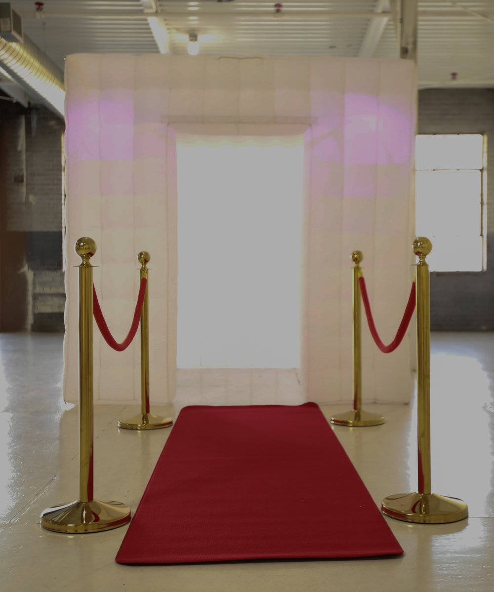 inflatable with red carpet & stanchions.jpg