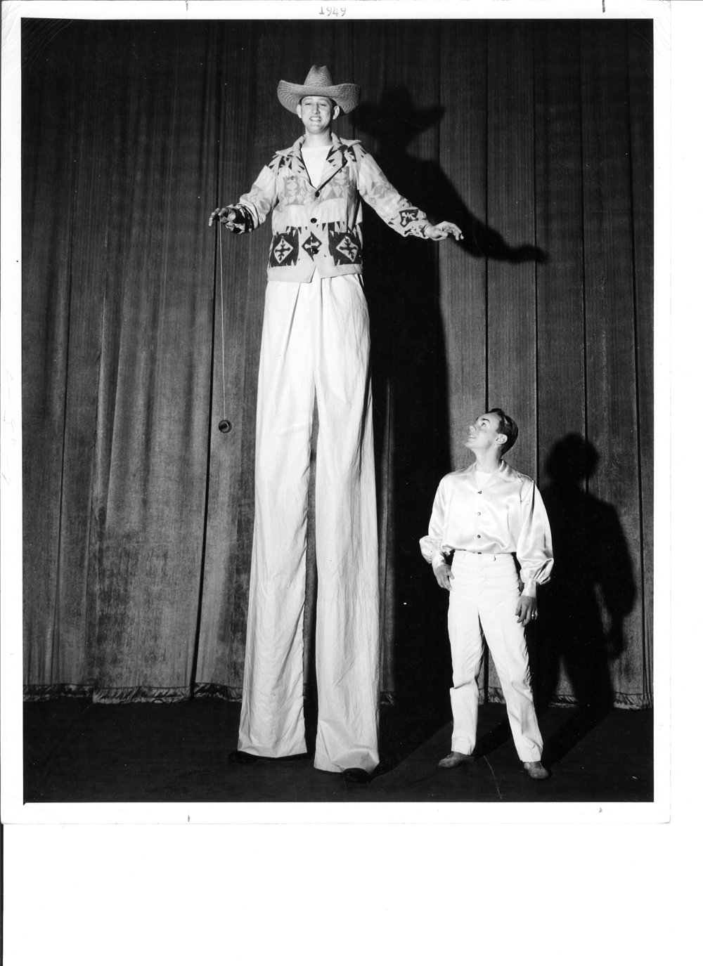 1949 Gene Wilburn on stilts as Gordon Zollinhofer watches.jpg