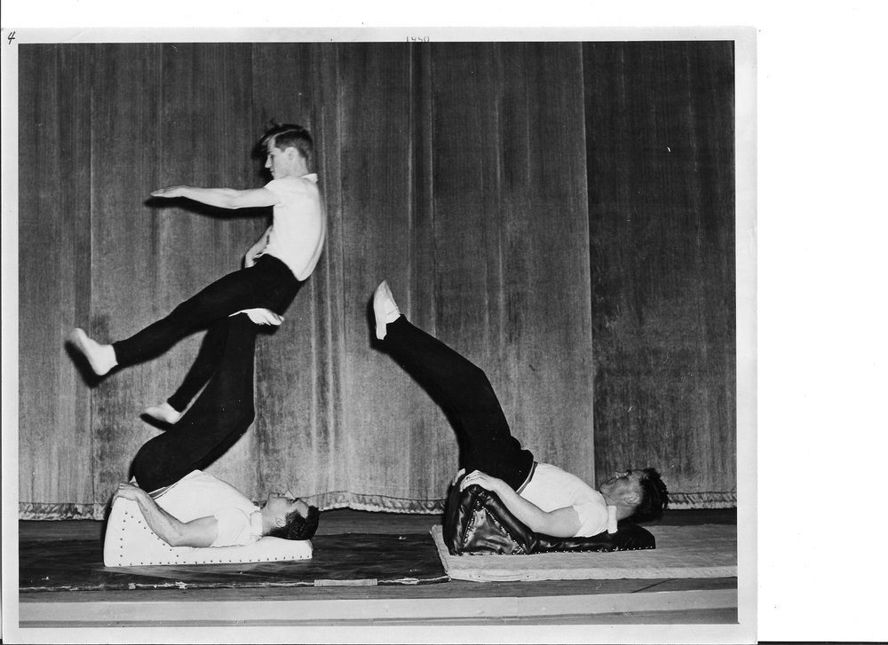 1950 Risley Tumbling - Bob Hooper catching Earl Newland who was thrown from Ollie Fejfar's feet.jpg