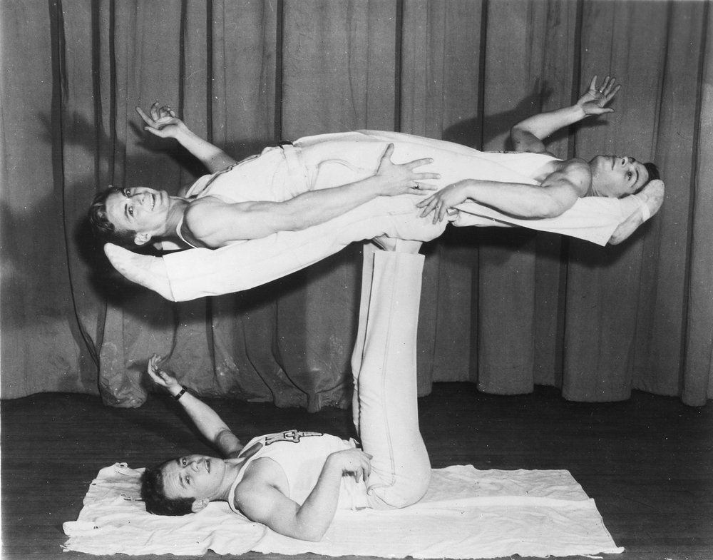 1948 'The Tremendors' executing a 'Double Mongolian' Harold Buckley as the understander, Al Kuckhoff left and Tom Bolgiano right lying horizontal.jpg