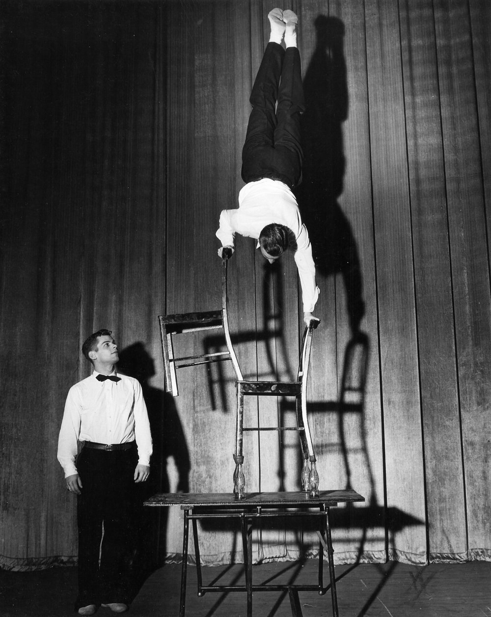 Gymkana 1949 illusion handstand on bottles performed by Al Kuckhoff, observed by Tom Bolgiano