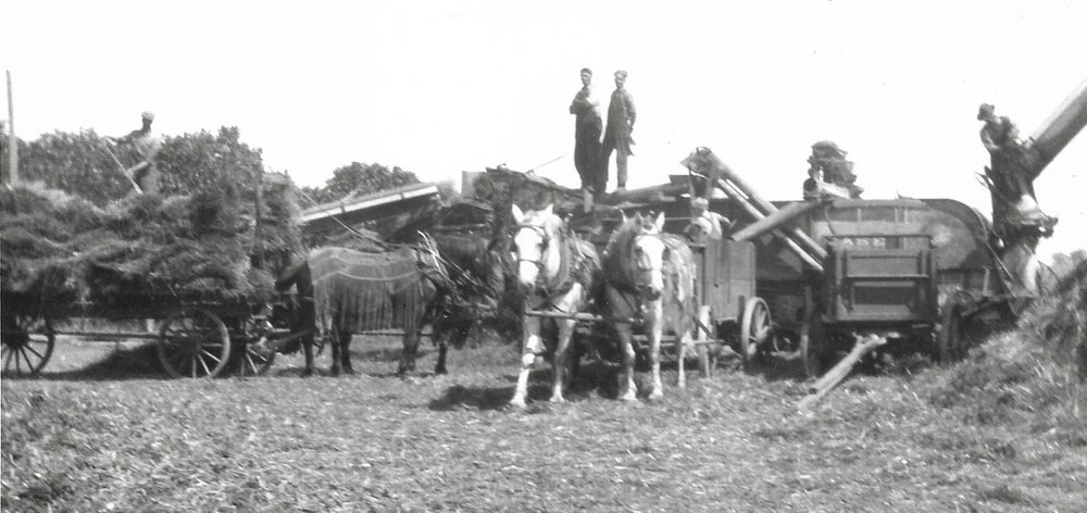 karl, Dave, And Charles Almquist on the Threshing machine