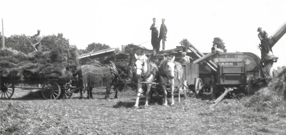 karl, Dave, And Charles Almquist on the Threshing machine