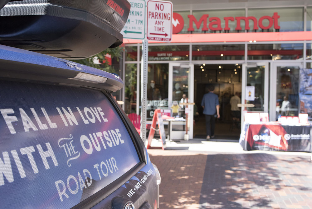 Road Tour Car parked outside a Marmot Store in Denver, before an event.