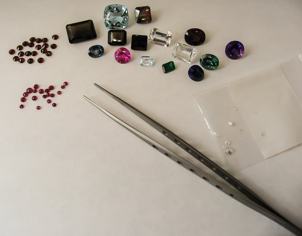 We remove all the gemstones and begin measuring them.