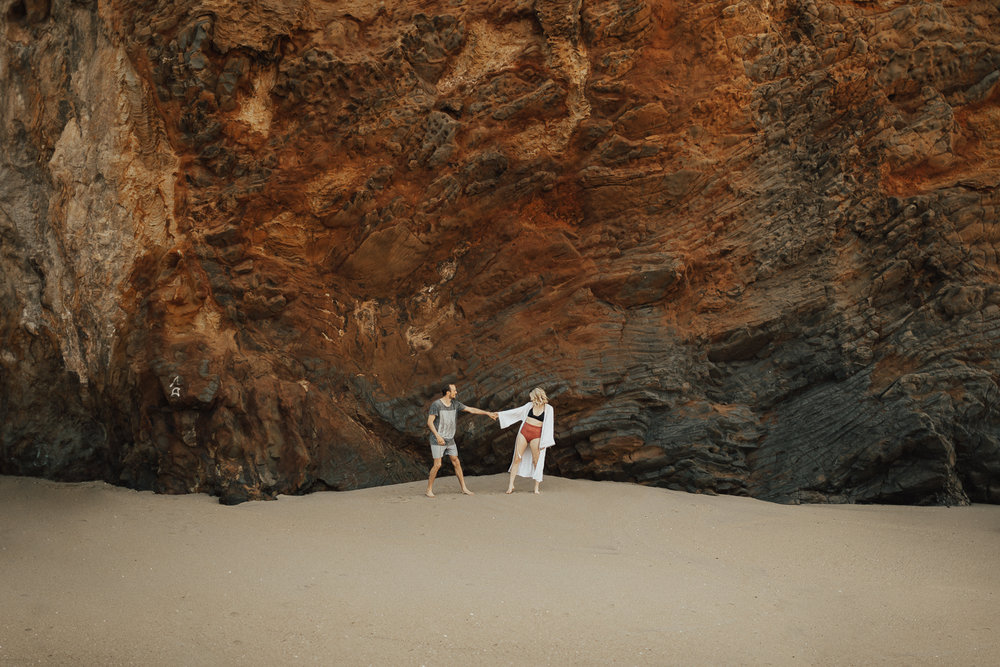 kumara + chris beach cliff flower field.jpg