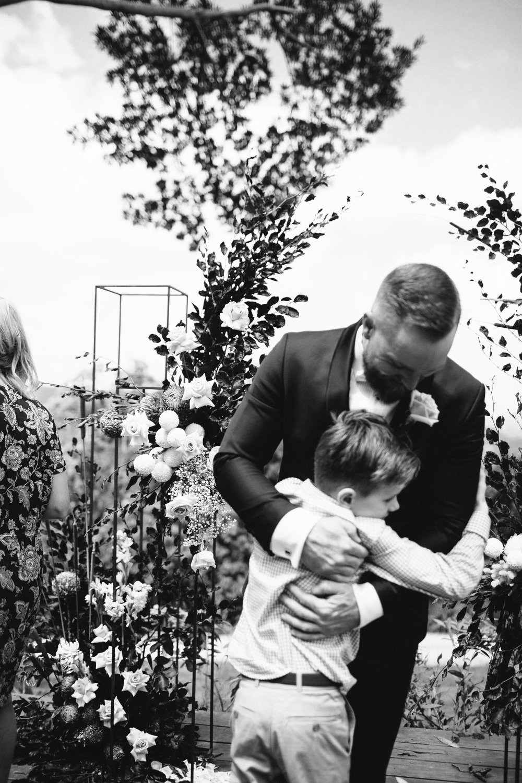 Bloodwood Botanica   Flower Altar hugs Altitude 261 wedding flowers